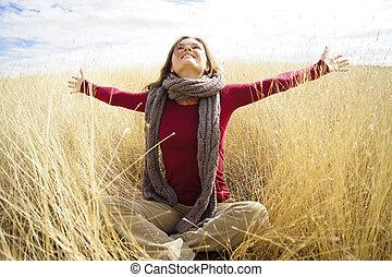 Joyful sunshine - Beautiful young woman enjoying sunshine in...