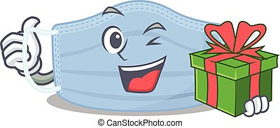 joyful surgical mask cartoon character with a big gift box. Vector illustration