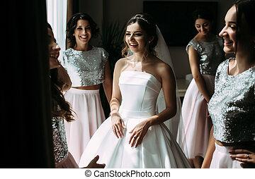 Joyful wedding preparation of the beautiful bride