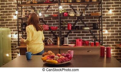 Joyful woman dancing doing housework in kitchen - Cheerful...