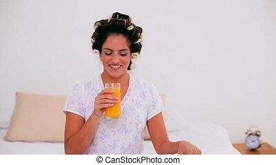 Joyful woman in hair curlers - Joyful brunette woman in hair...