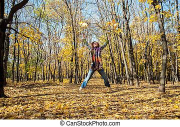 Joyful woman jumping for joy