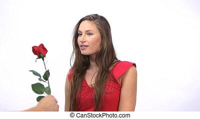 Joyful woman receiving a rose