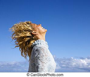 Joyful woman. - Side view of pretty woman holding head back...