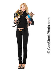 Joyful young blonde posing with two dogs