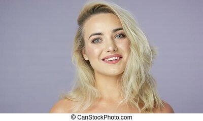 Joyful young blonde woman in studio - Headshot of joyful...