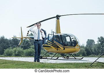 Joyful young businessman waiting for private pilot
