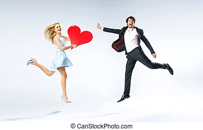 Joyful young couple during valentines - Joyful young couple...