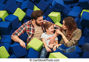 Joyful young family with their little son