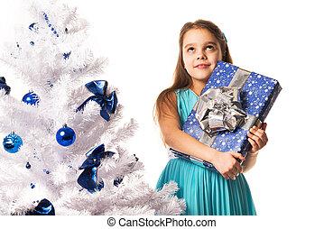 Joyful young girl in a blue dress