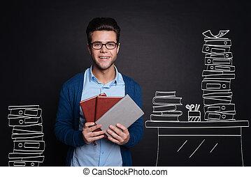 Joyful young man holding diaries.