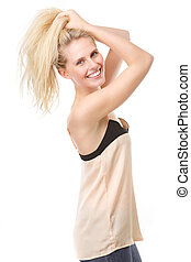 Joyful young woman with hands in hair