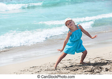 Joyous girl posing on sandy beach. Copyspace