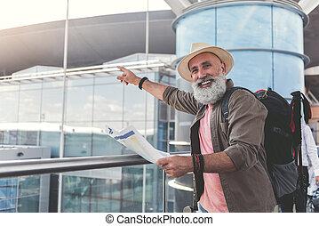 Joyous smiling elder male person having travel