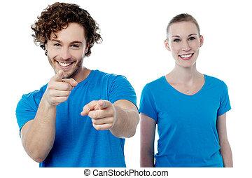 Joyous young couple having fun
