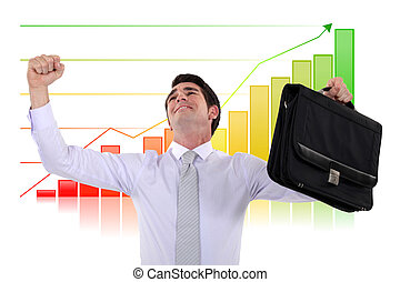 Jubilant businessman in front of a chart