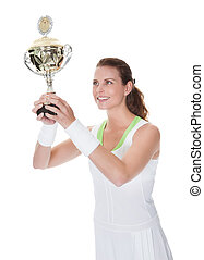 Jubilant winner holding up the trophy