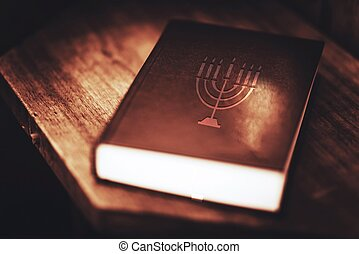 Torah Book Central Reference of the Religious Judaic Tradition. Menorah Symbol on the Book Cover