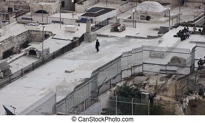 Judean man is walking on the roofs of Jerusalem - JERUSALEM,...