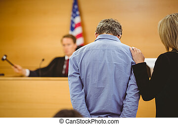 Judge about to bang gavel on sounding block in the court ...