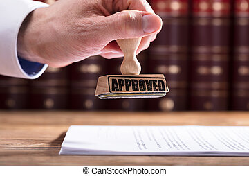 Judge Approving Contract Form - Close-up Of A Judge's Hand...