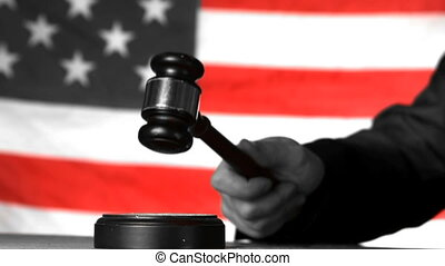 Judge calling order with gavel in american court in selective black and white in slow motion