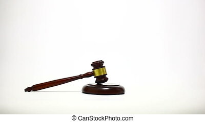 A wooden judge gavel and soundboard on a white background.