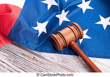 Judge gavel and american flag on wood.