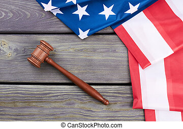 Judge gavel and American flag, top view.