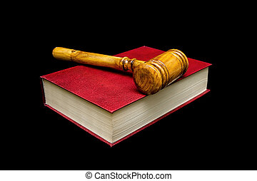 Judge gavel and book on a black background.
