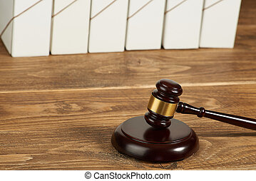 Judge gavel and file folders on wooden table.