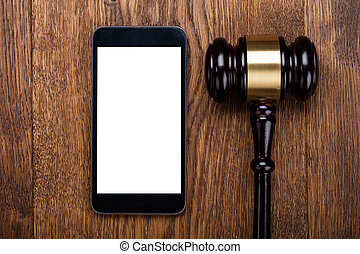 Judge Gavel And Smartphone On Wooden Desk