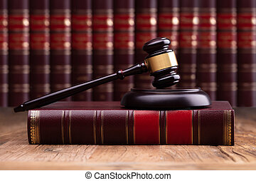 Judge Gavel And Soundboard On Law Book