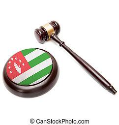 Judge gavel and soundboard with national flag on it - Abkhazia