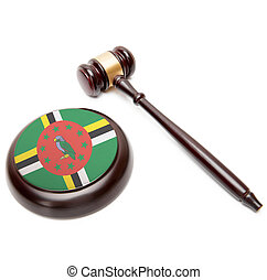 Judge gavel and soundboard with national flag on it - Dominica