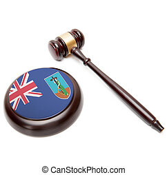 Judge gavel and soundboard with national flag on it - Montserrat