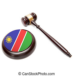 Judge gavel and soundboard with national flag on it - Namibia