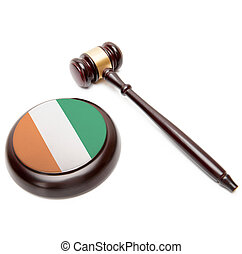Judge gavel and soundboard with national flag on it - Republic of Cote d'Ivoire - Ivory Coast