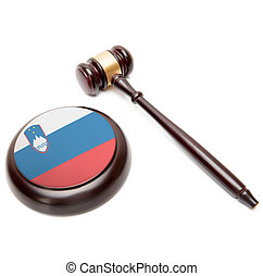 Judge gavel and soundboard with national flag on it - ...