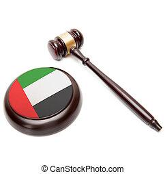 Judge gavel and soundboard with national flag on it - United Arab Emirates