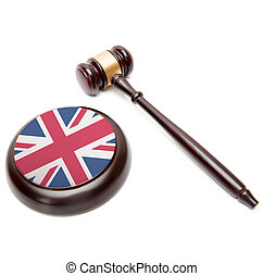 Judge gavel and soundboard with national flag on it - United Kingdom