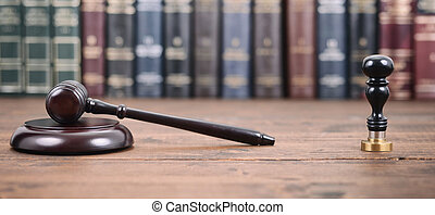 Judge Gavel , Notary seal and Law books on a wooden...