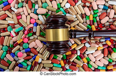 Judge gavel on drugs background - Law and drugs concept....