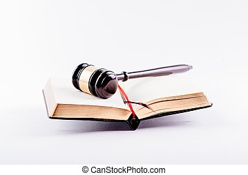 Judge gavel on legal codes.