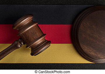 Judge gavel on the flag Germany. Law and justice. Constitutional law.