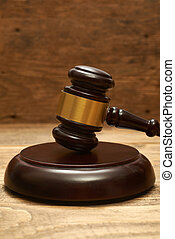 Judge gavel on wooden table.