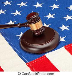 Judge gavel over US flag - closeup studio shot