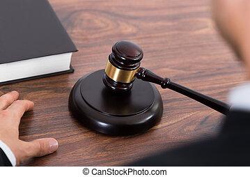 Judge Hitting Mallet At Desk