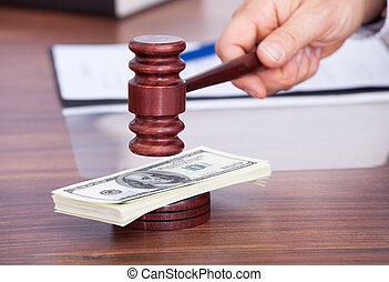 Judge Hitting Mallet On Banknote