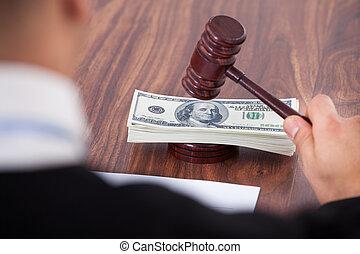 Judge Hitting Mallet On Banknotes